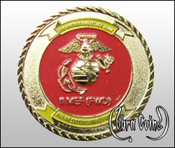U.S. Marine Corps emblem minted in 3D on a shiny gold coin.