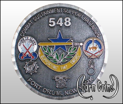 Combat Sustainment Support Battalion from Fort Drum, New York. Wave edge cut on an antique brass coin.