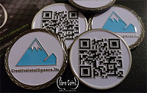 2D Front and 2D Back Shiny Silver coin with a Diamond Edge cut on one side and enamel colors on both sides CreativeIntelligence LLC coin using their custom QR code cobra coins cobracoins.com